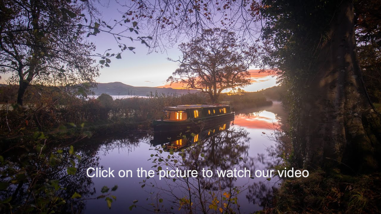 A canal boat in the early autumn light
