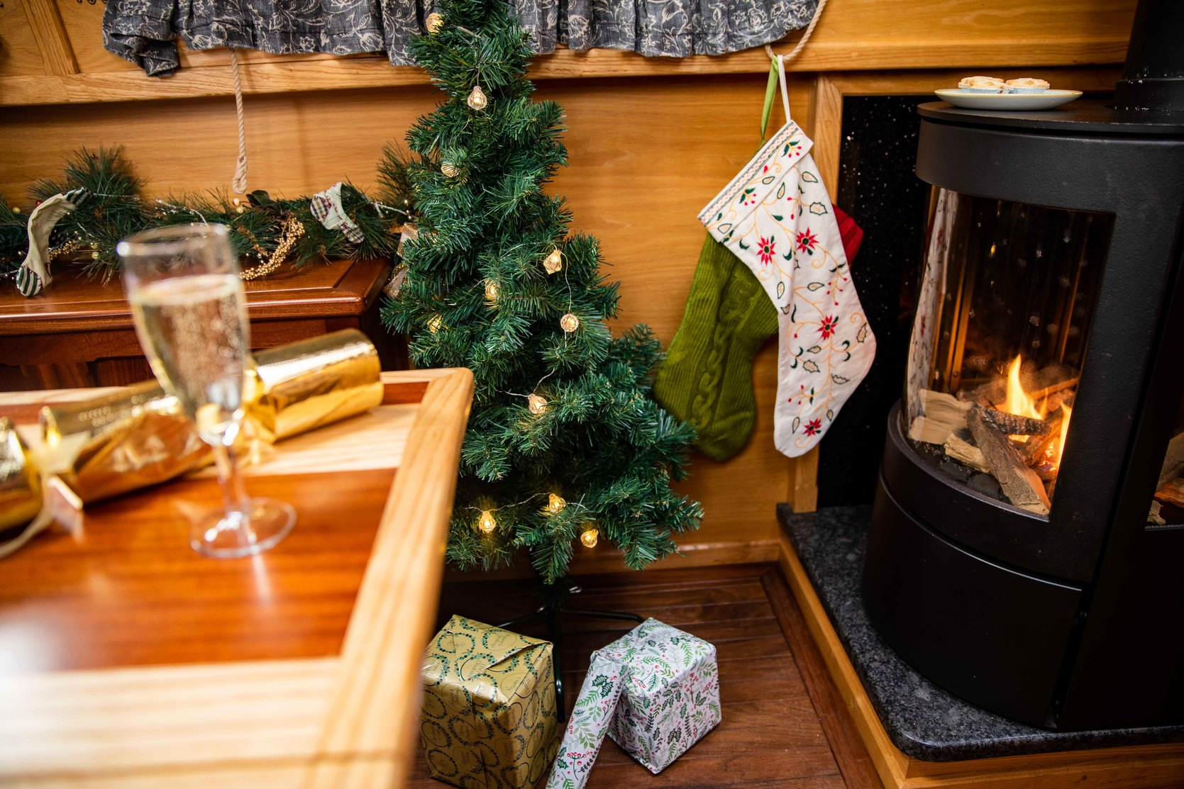 Presents under a tree by a canal boat sove