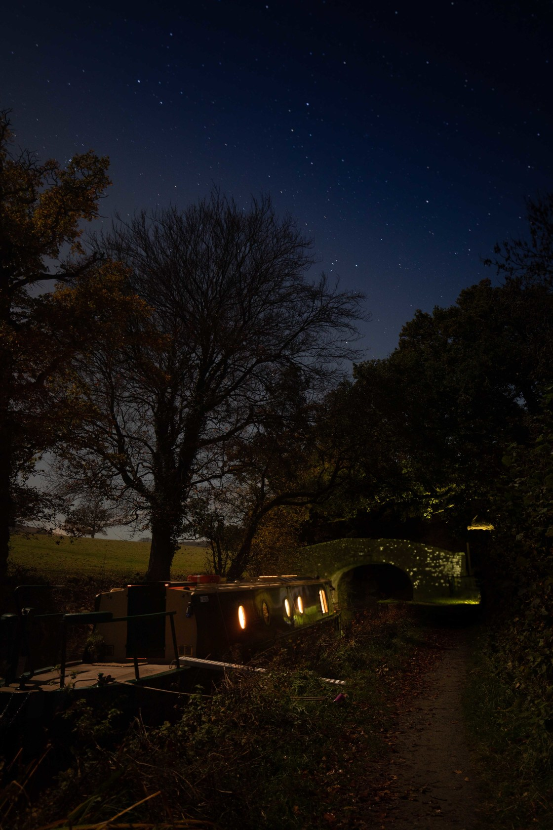Canal boat under starry skies